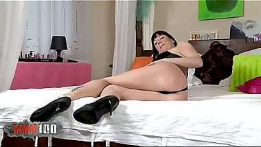 Horny grandma brunette Jakeline Dove dancing and stripping on the bed