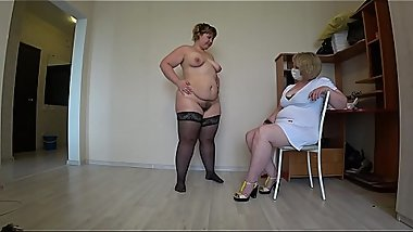 Mature nurse helps a plump lesbian with orgasm problems, fisting in medical gloves. POV.